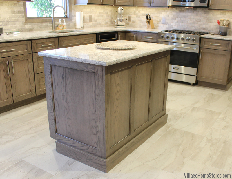 Dura Supreme Cabinetry in Red Oak wood and gray stain paired with Cambria Berwyn Quartz counters. Kitchen design by Angela Weisbrod and remodeled from start to finish by Village Home Stores.