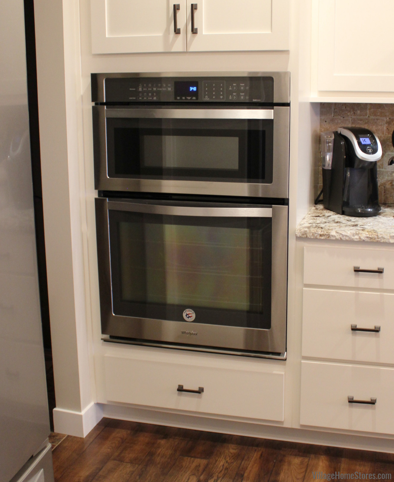 Whirlpool combination wall microwave convection oven in Stainless Steel. Kitchen design and appliances from Village Home Stores for Hazelwood Homes. Geneseo/Quad Cities