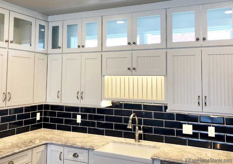 Natural light can pour in from the backless design of these glass-front cabinets in Prophetstown, IL. Kitchen cabinetry and quartz countertops from Village Home Stores for Hazelwood Homes of the Quad Cities.