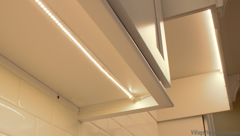 LED tape Diode undercabinet lighting system installed with a low profile beneath a kitchen cabinet. Design and product from Village Home Stores.