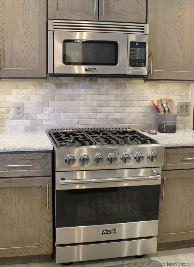 Viking gas range and microwave hood in a Quad Cities area kitchen. Village Home Stores is the largest Viking appliance showroom in the region. | villagehomestores.com