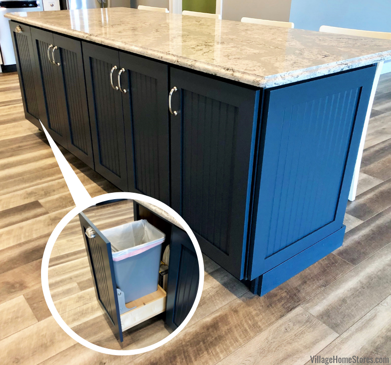 Gale Force Dura Supreme island cabinetry with pullout wastebasket cabinet in a Prophetstown, IL kitchen. Design and materials from Village Home Stores for Hazelwood Homes of the Quad Cities.