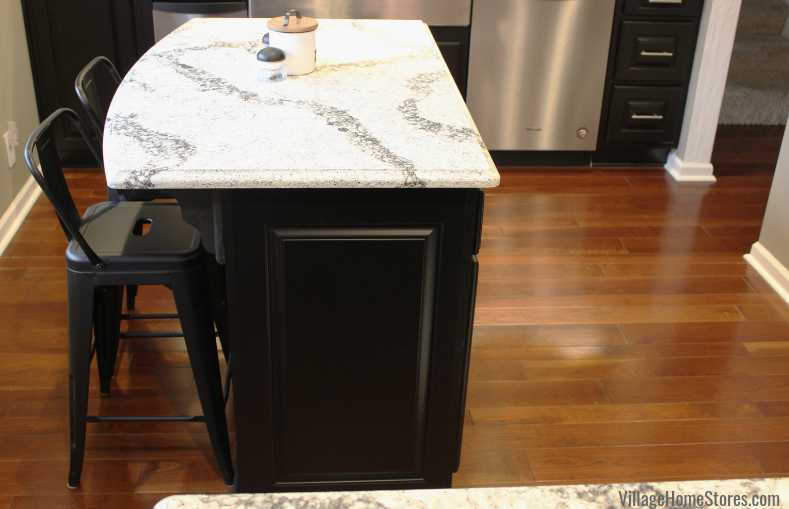 Black painted kitchen cabinetry with small island and Cambria Quartz in the Seagrove design. Kitchen design by Angela Weisbrod and complete kitchen remodel from start to finish by Village Home Stores.