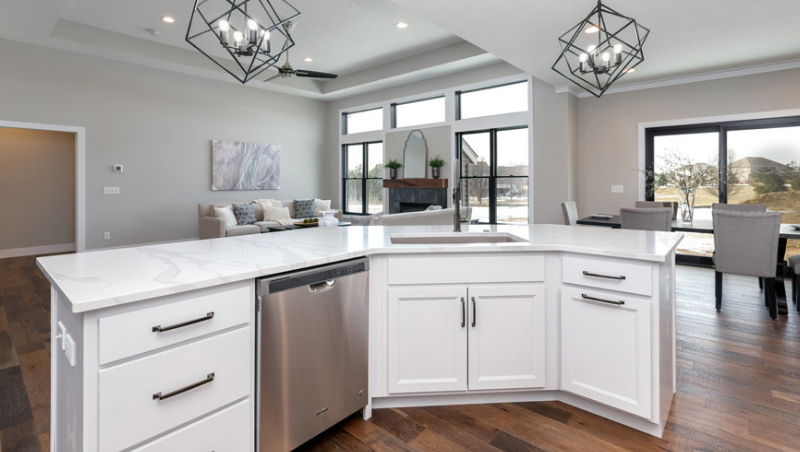 Unique kitchen with angled island in Bettendorf, Iowa. Cabinetry, Quartz, and Whirlpool appliances by Village Home Stores for McCoy Homes, Quad Cities.