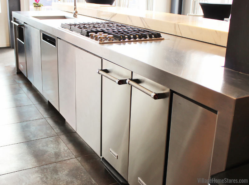 Row of undercounter appliances from KitchenAid installed in a kitchen island.