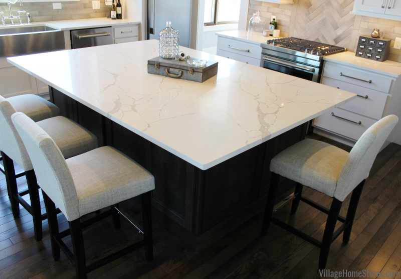 Marble look kitchen counters in Seagrove design. Kitchen design, cabinetry, and counters from Village Home Stores for Applestone Homes Quad Cities.