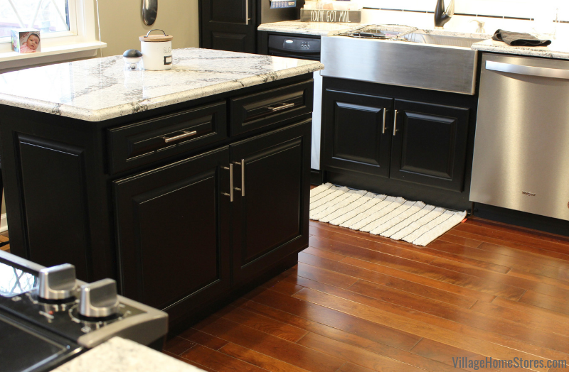 Black painted kitchen cabinetry with small island design in Taylor Ridge, IL. Kitchen design by Angela Weisbrod and complete kitchen remodel from start to finish by Village Home Stores.