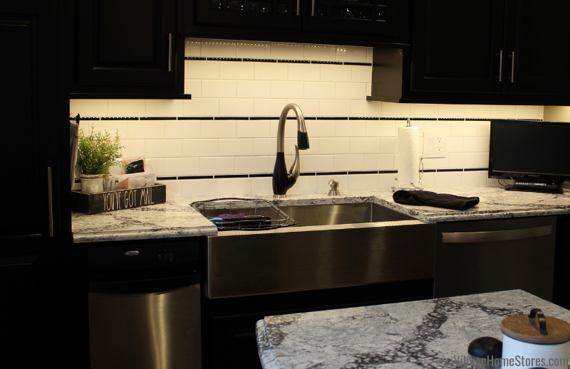 Subway tile with black pencil rail accent. Tile and complete kitchen remodel from start to finish by Village Home Stores.