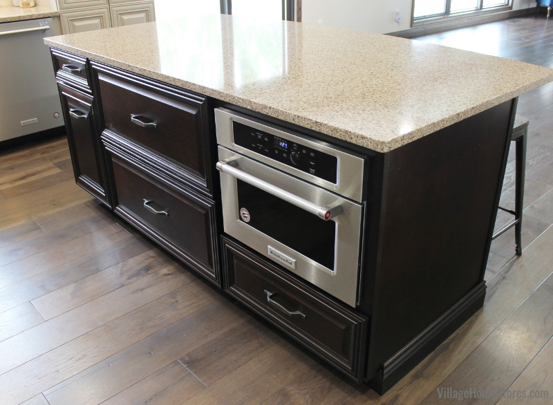 "Birch island cabinetry in the dark ""Java"" stain from our Koch line and microwave built in."