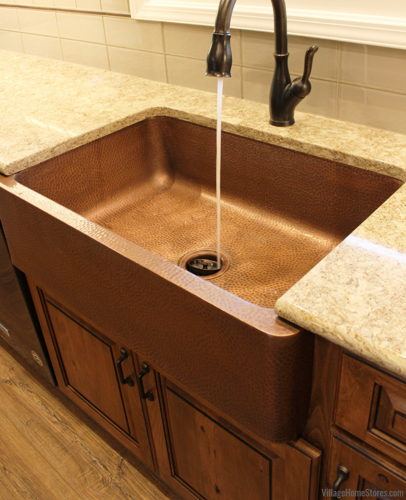 Sinkology Hammered Copper single-well farmhouse sink in an East Moline, IL kitchen remodeled by Village Home Stores.