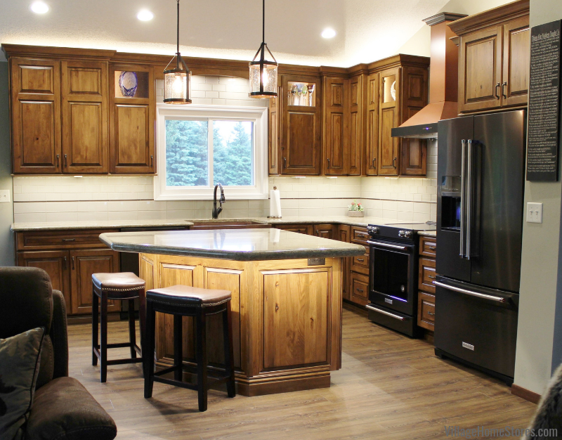 Rustic Beech kitchen with Cambria quartz counters, Vinyl Plank flooring, and Black Stainless KitchenAid appliances. Kitchen remodeled from start to finish by the Quad Cities kitchen experts at Village Home Stores.
