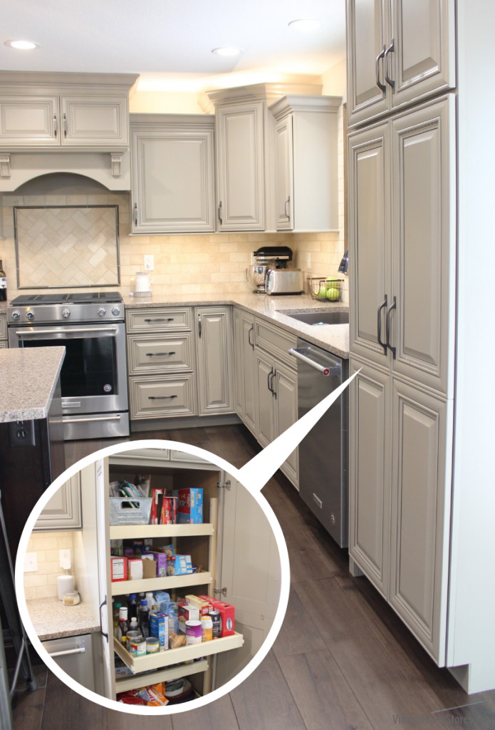 Koch Taupe painted kitchen cabinets with tall pantry and roll out shelves.