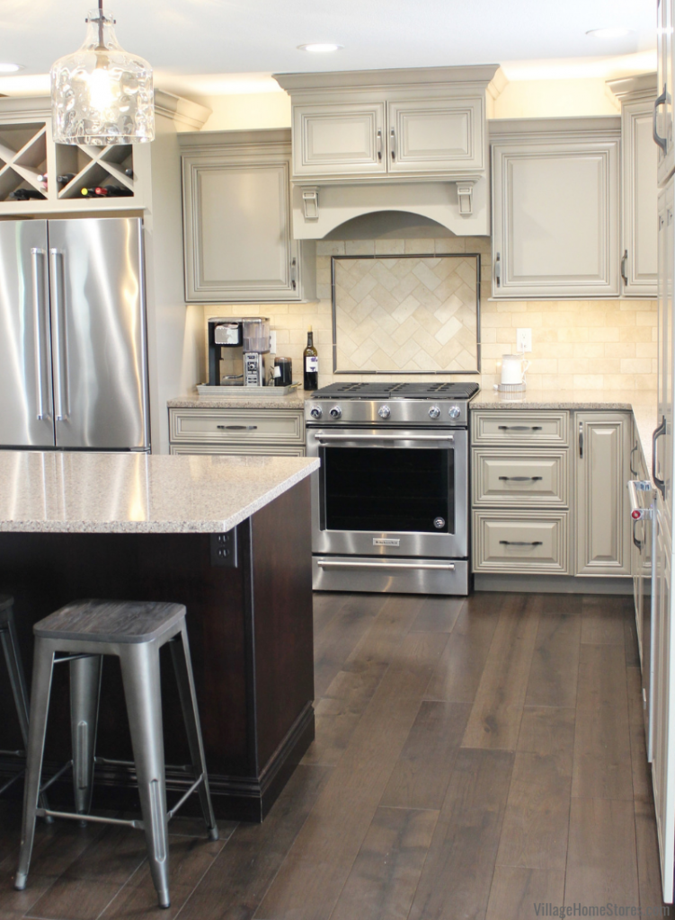 Farmhouse kitchen design in Kewanee, IL with Taupe painted cabinetry with accent glaze and dark Java island.