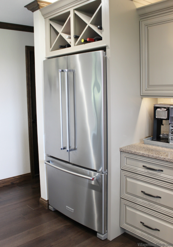 French Door KitchenAid refrigerator with wine storage above in a Kewanee, IL farmhouse kitchen remodel with design and products from Village Home Stores.