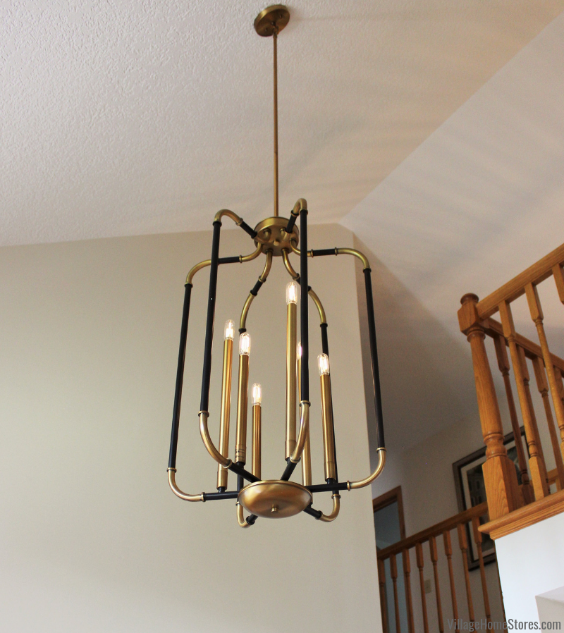 Black and gold Liege foyer light from Minka Lavery hanging in a Bluegrass, Iowa foyer.