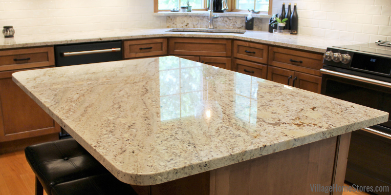Natural stone Makala Bay Granite countertops. Kitchen design and remodel in Bluegrass, Iowa by Village Home Stores.