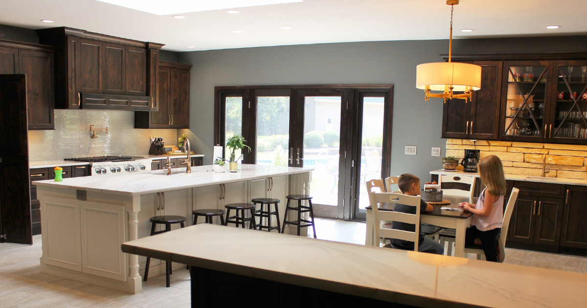 kitchen island and table with family sitting around it