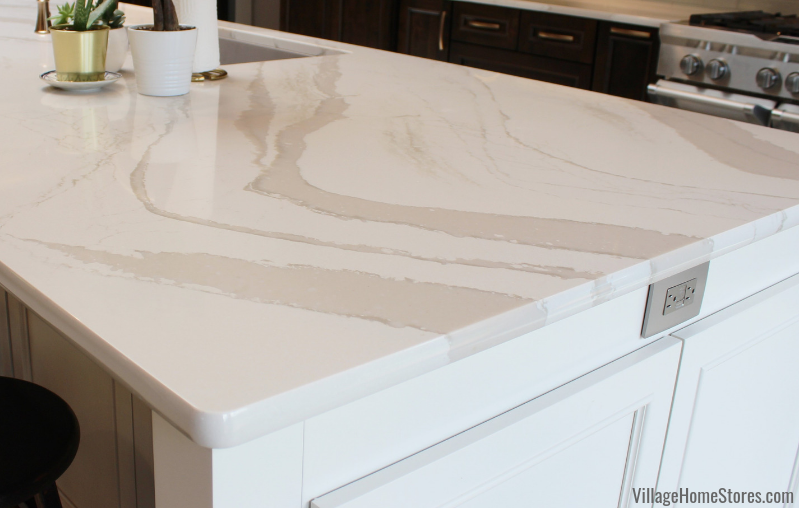 White marble look Cambria Quartz in the Brittancca Warm design installed in a Quad Cities area kitchen.