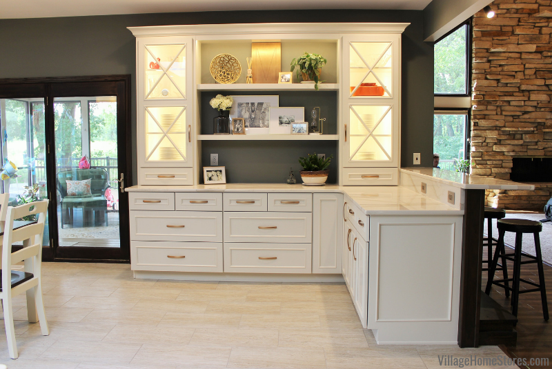 Custom hutch area with peninsula base cabinets, glass door cabinets, and open shelves.