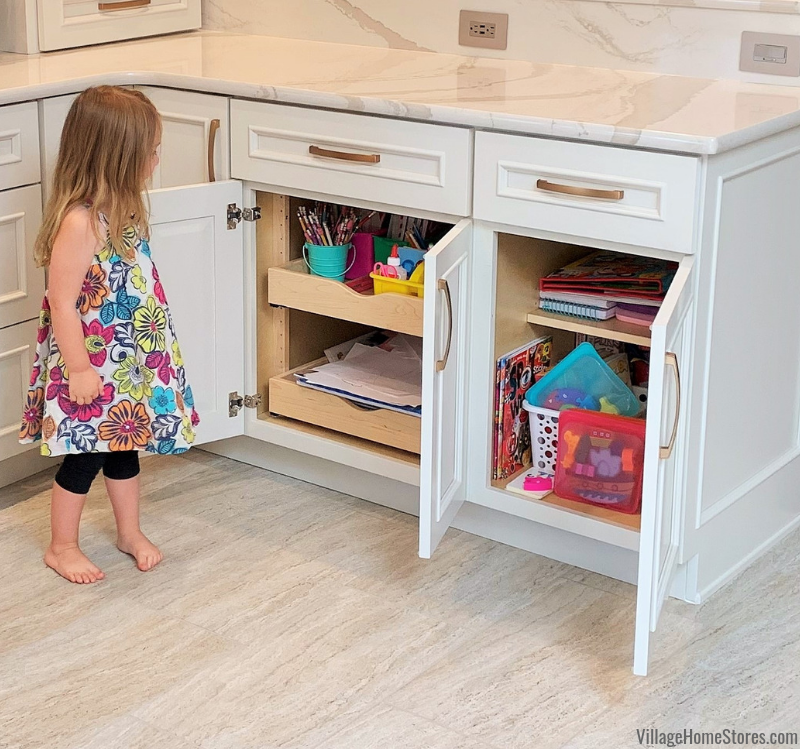 Kitchen storage area for kids craft supplies. Kitchen cabinetry, counters, appliances, and surfaces by Village Home Stores.