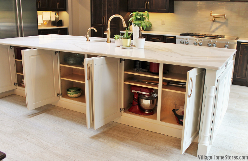 Kitchen island design with usable back storage. Kitchen cabinetry, counters, appliances, and surfaces by Village Home Stores.