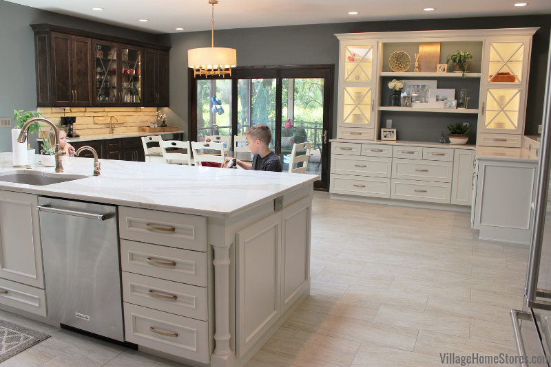 Kitchen design with large island, hutch, and wetbar area. Kitchen design by Rachel Tingley with product and complete remodel by Village Home Stores.