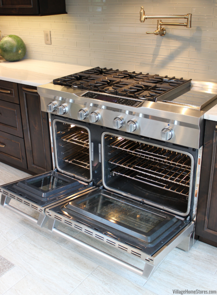 48 inch KitchenAid Dual Fuel range with two ovens gas cooktop and chrome griddle.