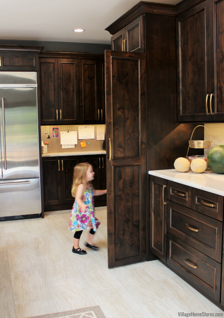 Walk in pantry front matches the kitchen and offered a hidden pantry entrance from the main kitchen. Kitchen design and remodel by Village Home Stores.