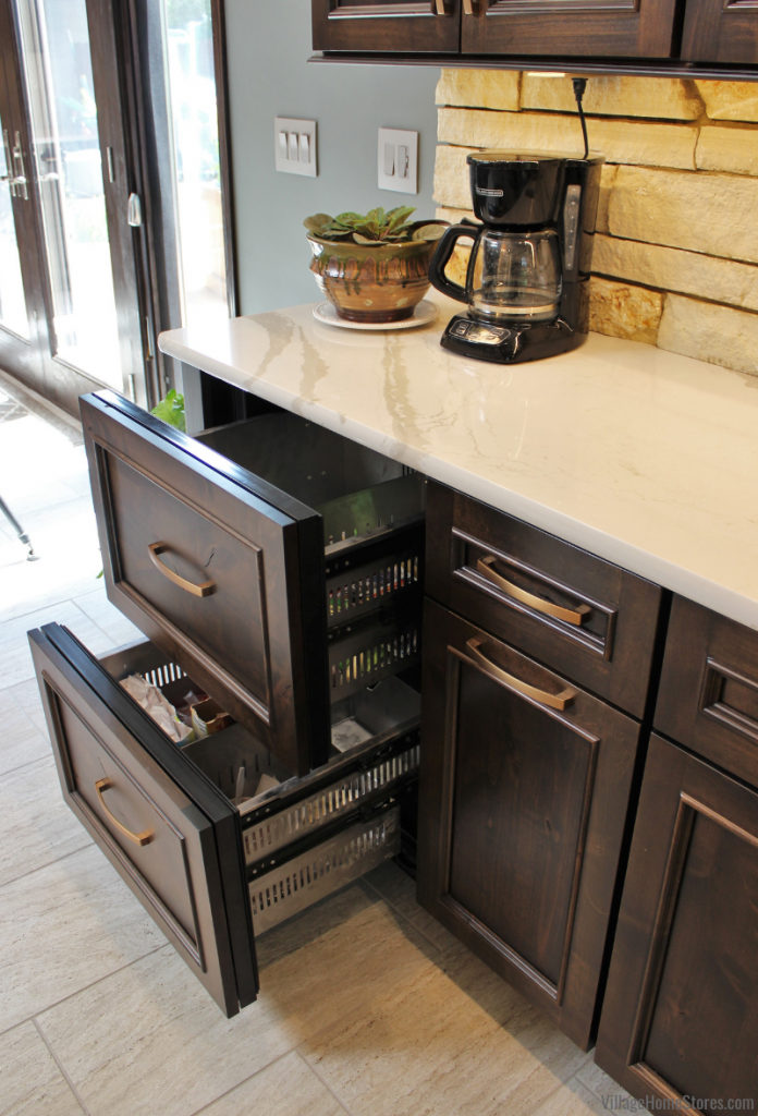KitchenAid panel-ready refrigerator and freezer drawers in a custom wet bar area.