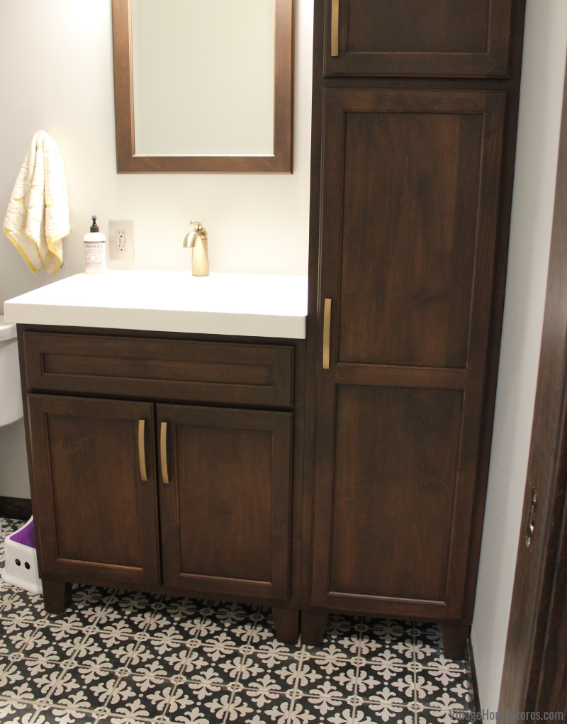 Bertch Bath vanity cabinets with farmhouse tile flooring. Start to finish bath remodel by Village Home Stores.