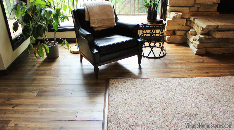 Paramount Rustic Beam flooring with Dream Weaver carpet inlay in Symphony Swing color.