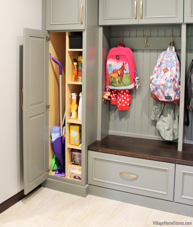 Custom Amish built mudroom storage with cleaning supply pantry. -Village Home Stores.