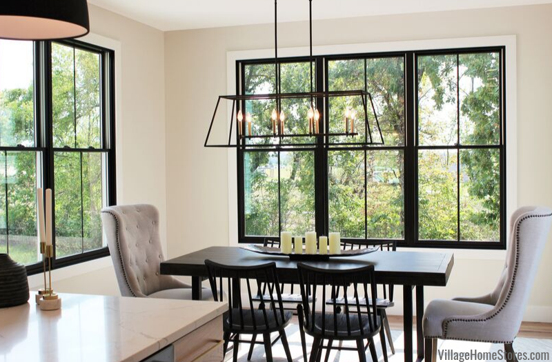 Farmhouse light hangs in a farmhouse styled dining area of a Bettendorf home.