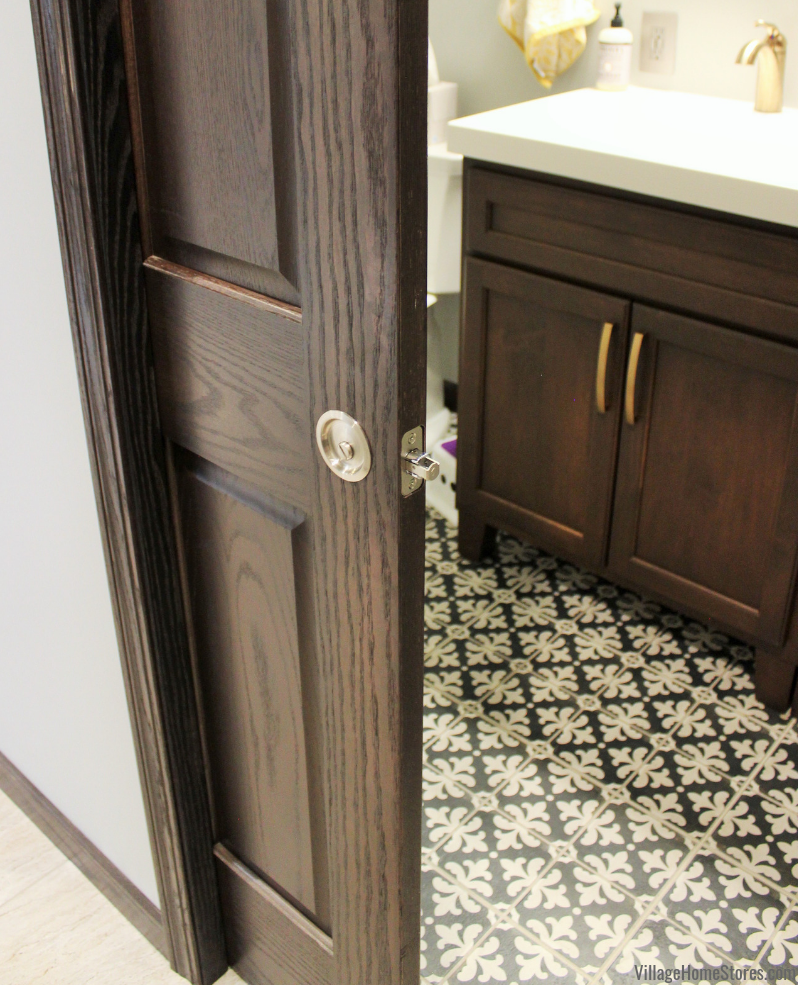 Powder room pocket door and Stonepeak Palazzo Florentina 12 x 24 large format farmhouse tile flooring.