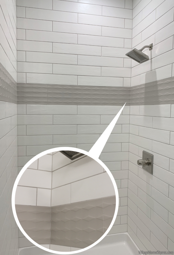 Long white subway tile with gray grout in a custom tiled shower. Tile from Village Home Stores in a Quad Cities area home built by Silverthorne Development.