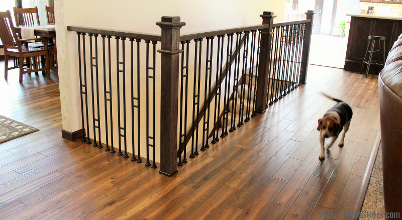 New iron stair railing and Paramount Rustic Beam flooring in a Coal Valley, IL great room. Materials and complete start to finish home remodel by Village Home Stores.