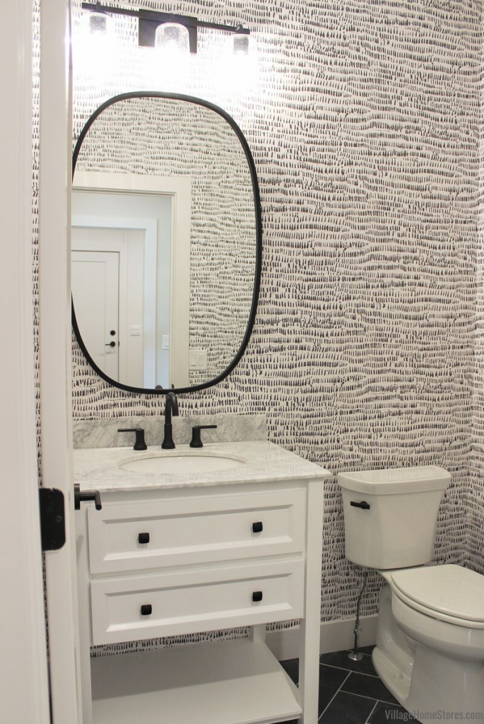 White bath vanity with marble top in a Bettendorf Quad Cities wallpapered powder room.
