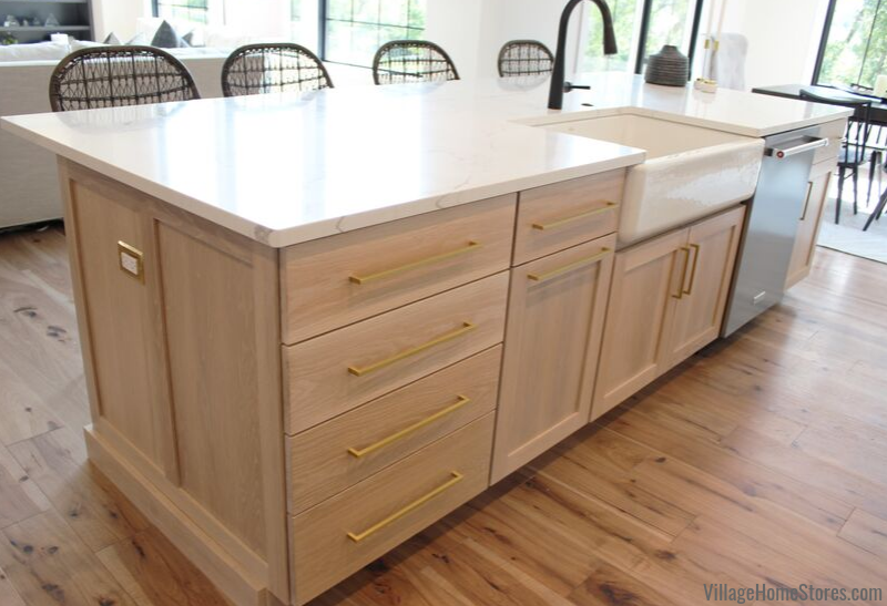 White oak kitchen island with farmsink in a Bettendorf Quad Cities home. Kitchen design and materials by Village Home Stores for Aspen Homes.