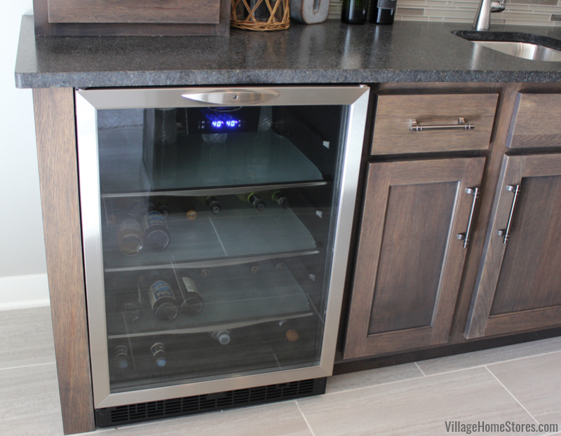 Danby glass door beverage cooler in a Bettendorf home bar. Appliances by Village Home Stores.
