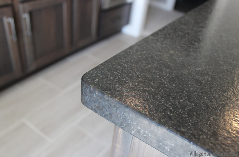 Black Pearl Brushed Granite countertops in a Bettendorf home bar. Design and materials by Village Home Stores.