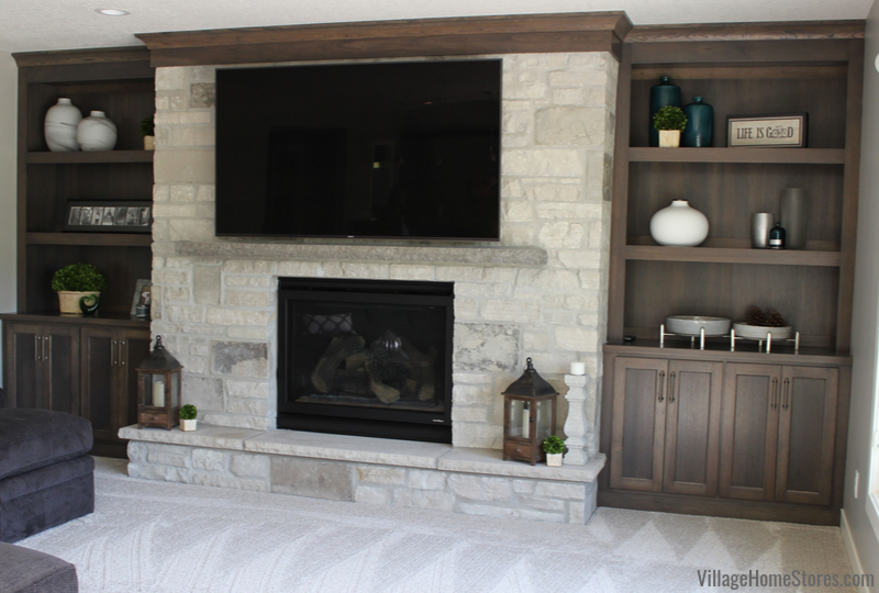 Bettendorf Quad Cities fireplace wall with built in cabinets in Stone stained Hickory by Village Home Stores.