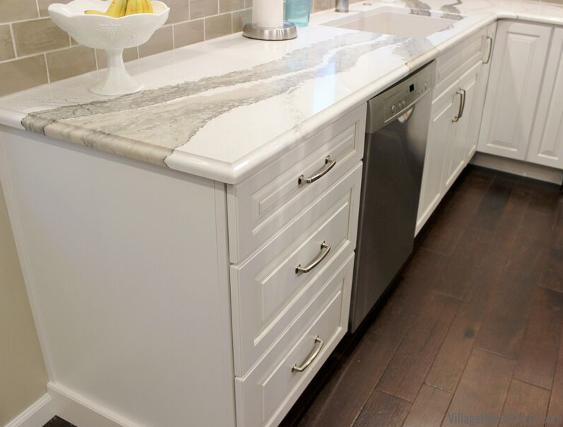 White kitchen with Cambria quartz counters in an Ogee Edge.