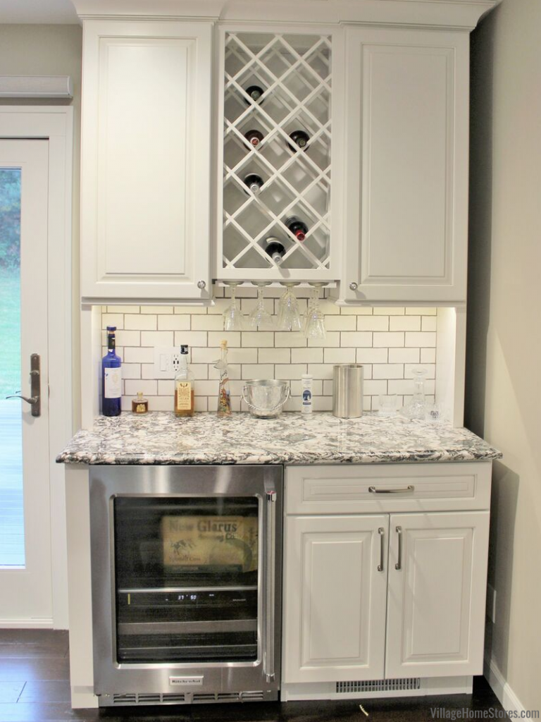 Dry bar area with wine storage and beverage cooler. Complete remodel by Village Home Stores.
