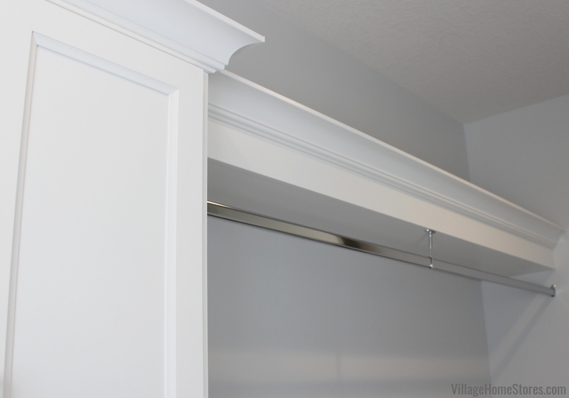 Laundry room hanging rod for air drying items. Trimmed out with top shelf and crown molding.