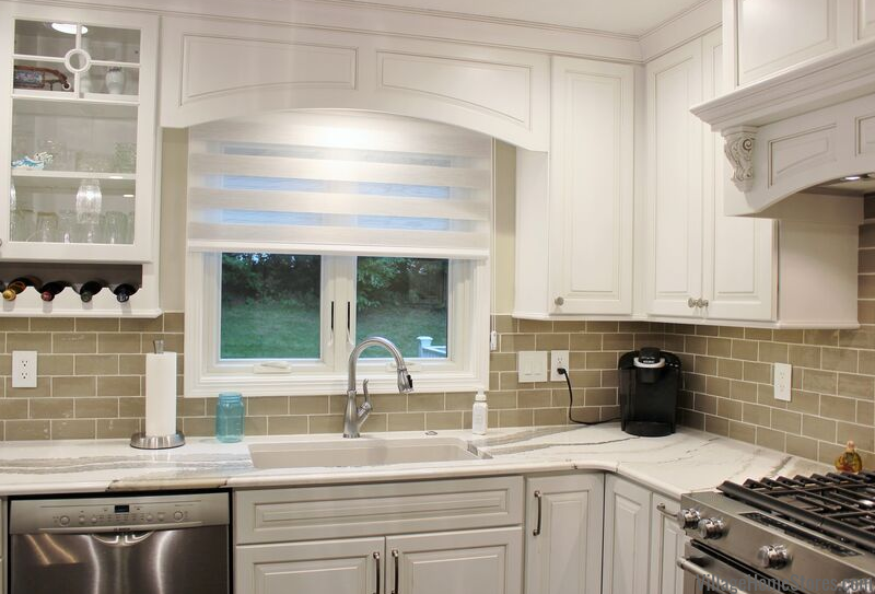 Transitions kitchen window shade with wood decorative valance above sink.