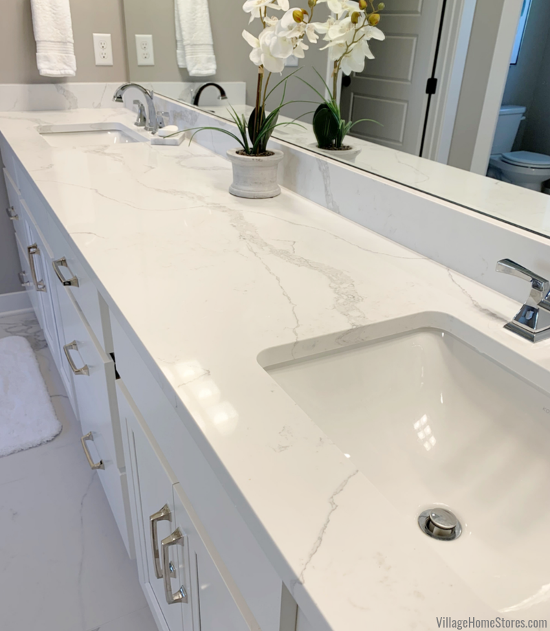 Master Bathroom vanity with white cabinets and Calacatta Verona quartz counters. Design and materials by Village Home Stores in a Bettendorf, Iowa home.