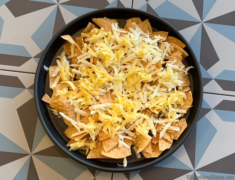 Grated nacho cheeses over nachos recipe.