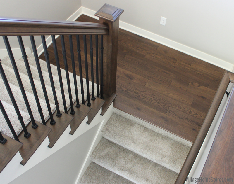 Combination of wood and carpet on stairs in a Quad Cities area home. Dreamweaver carpeting in Metropolitan Iron Frost color and Engineered Oak in Saddle finish.