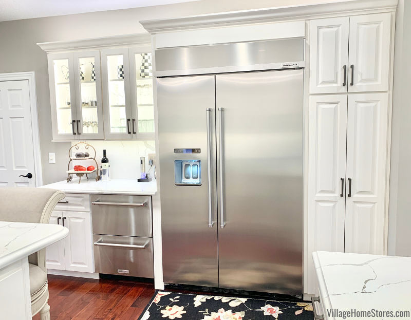 KitchenAid 48 inch wide built in refrigerator installed in a white kitchen. Kitchen appliances, design, and remodel by Village Home Stores