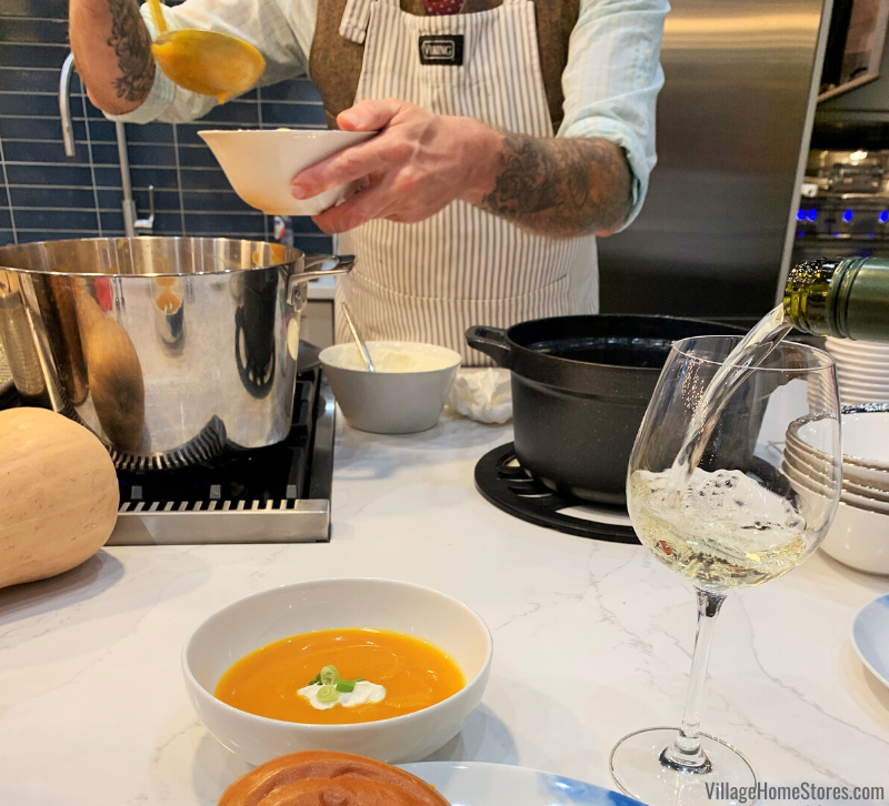 Chef Jaime Laurita pours some soup as he demonstrates Viking products in the Middleby Residential showroom in Chicago Merchandise Mart.